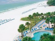 Pool and beach at the Tradewinds Island Grand - Florida Holidays