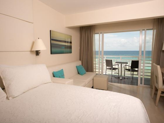 The SoCo Hotel Deluxe bedroom with ocean views