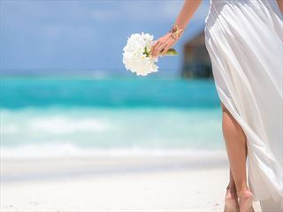 Bride on the beach, walking to her Renewal of Vows ceremony