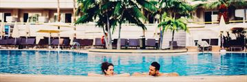 Couple in pool at Arona Gran Hotel