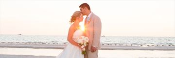 Bride and groom at sunset, on Clearwater Beach