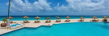 Pool and Loungers at Frangipani Beach Hotel