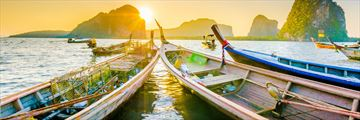 Long boats at sunset in Krabi