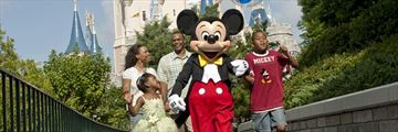 Mickey hanging out with a family at Walt Disney World Resort