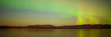 Northern Lights mirroring Lake Laberge, Yukon