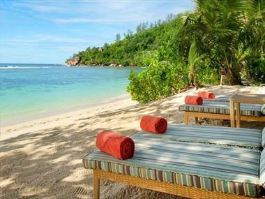 Beachfront loungers at Kempinski Seychelles Resort