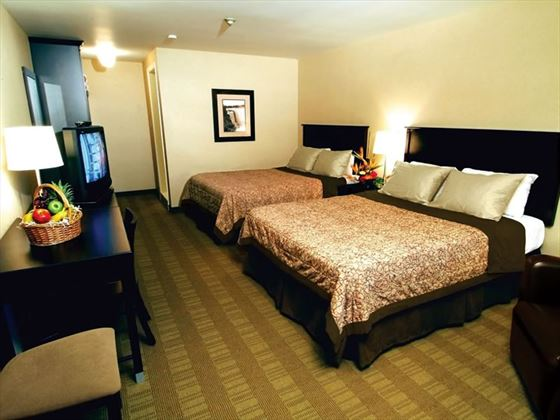 Traditional two queen bed guestroom