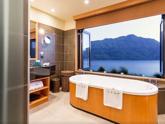 Bathtub by bay window