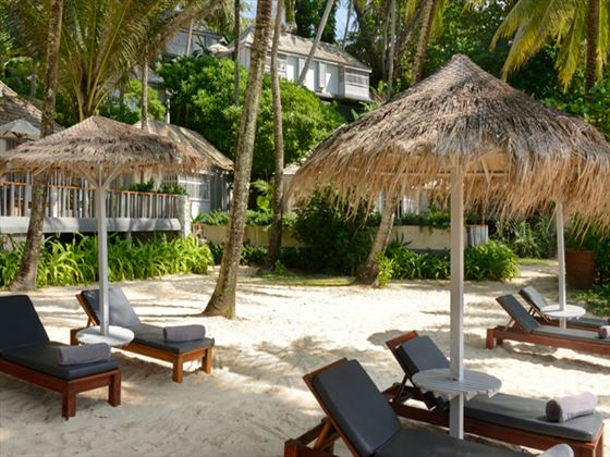 Beach loungers at The Surin Phuket