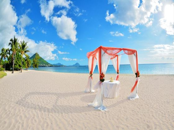 Barefoot beach wedding setting