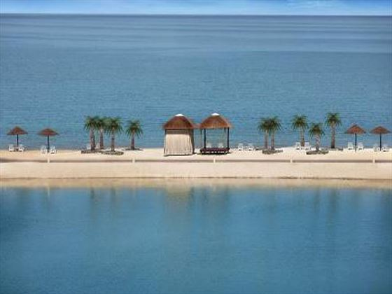 Beachfront gazebos at The Cove Rotana