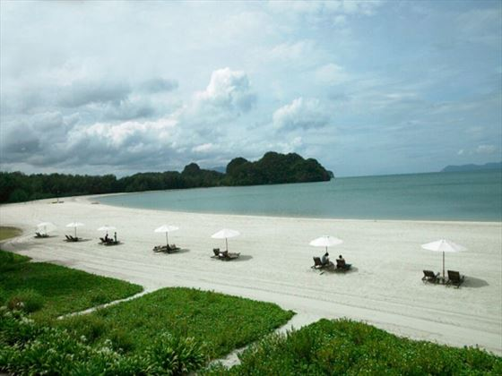 Beachfront loungers at the Tanjung Rhu Resort