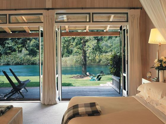 Bedroom and view at Huka Lodge