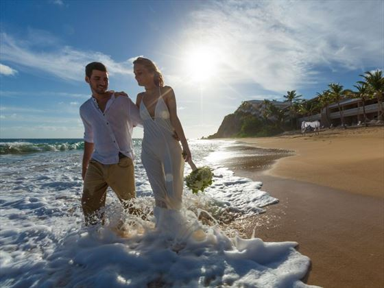 Newly wed beach stroll at Curtain Bluff