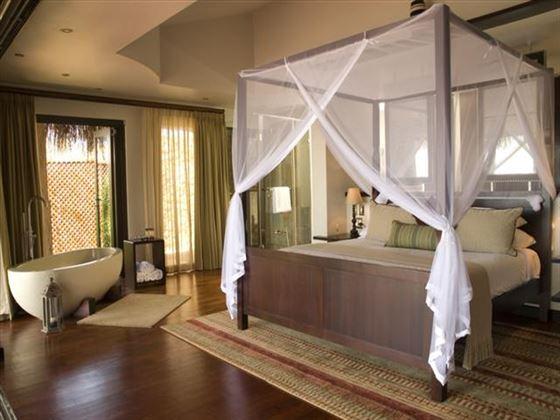 Chalet bedroom at Indigo Bay Resort & Spa