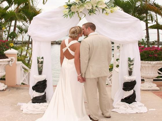Couple at the wedding arch