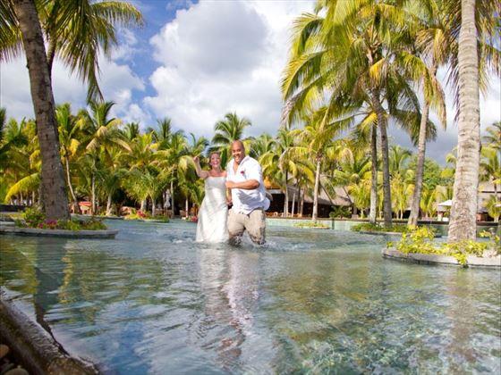 Newlyweds in the ocean