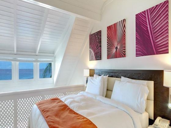 Crystal Cove by Elegant Hotels One-bedroom Suite bedroom