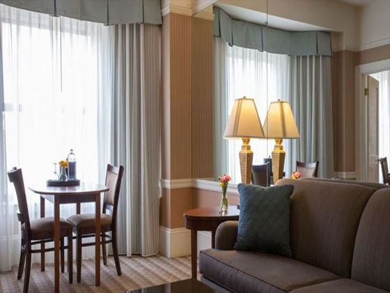 Deluxe Level King Suite living room at The Prescott Hotel
