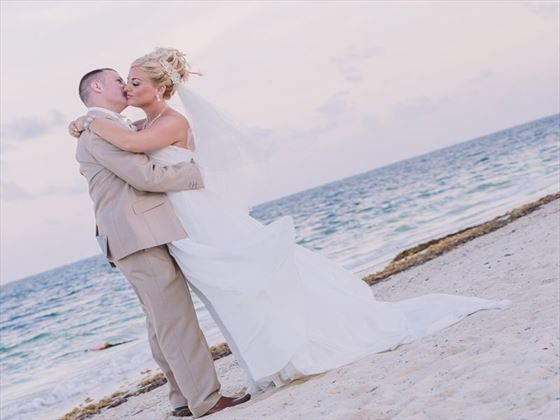 Bride & groom on the beach at Dreams Riviera Cancun Resort & Spa