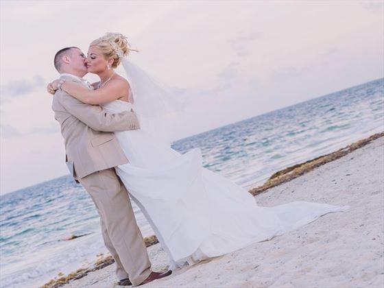 Bride & groom on the beach at Dreams Riviera Cancun Resort & Spa