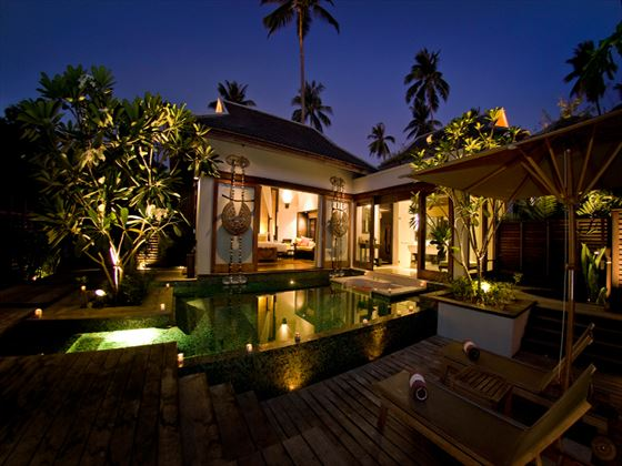 Exterior view of a Pool Villa at night at Anantara Phuket Villas
