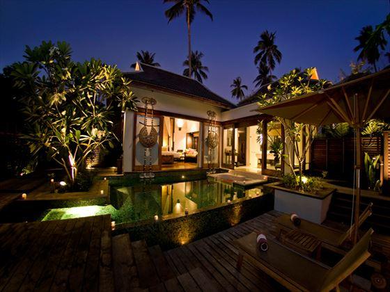 Exterior view of a Pool Villa at night at Anantara Phuket Villas