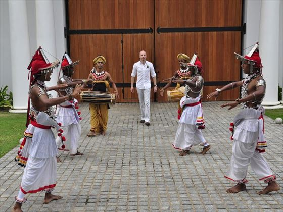 Groom being escorted to the ceremony by dancers & drummers