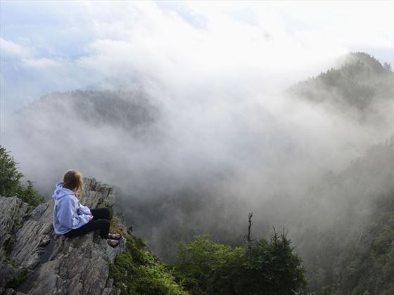 Girl perched atop Mount LeConte on the Great Smokies hiking trail