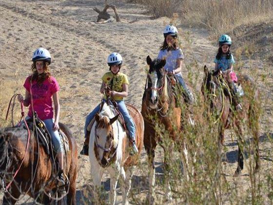 Kids riding horseback at Tanque Verde Ranch