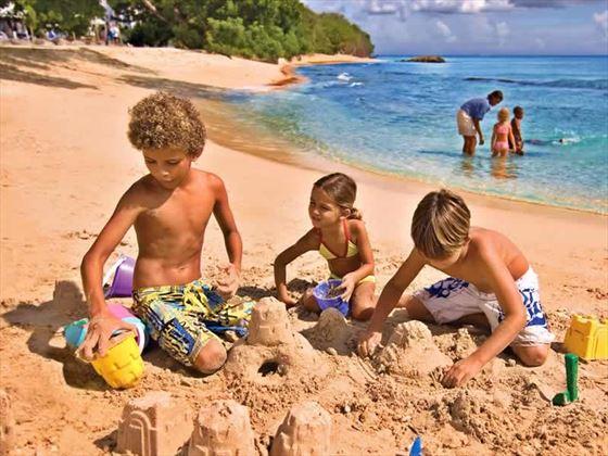Kids on the beach at Almond Beach Resort