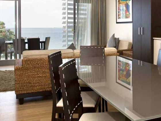 Living and dining area at Sea Spray Suites