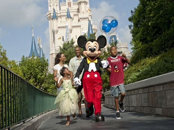 Mickey Mouse and guests at Disney's Magic Kingdom