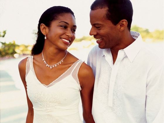 Newlyweds on the beach at Couples Swept Away