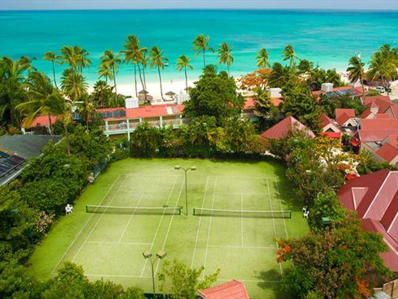 Outdoor tennis courts at Sandals Grande Antigua Resort & Spa