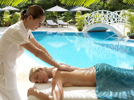 Poolside spa treatment at Royal Hideaway Playacar