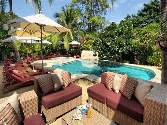 Poolside sun loungers at Zazen Boutique Resort