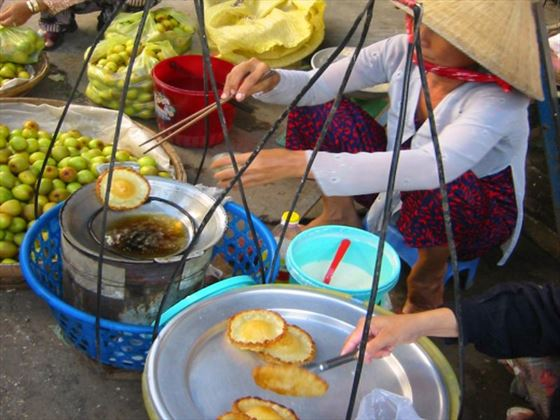 Street food vendors serving traditional cuisine
