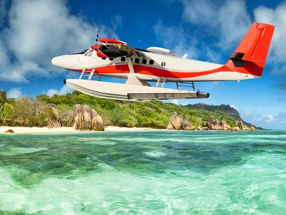 Seaplane flying over La Digue