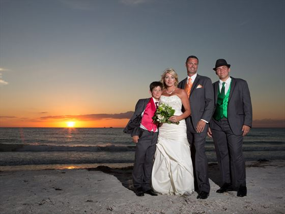 Family & friends gather for a sunset wedding