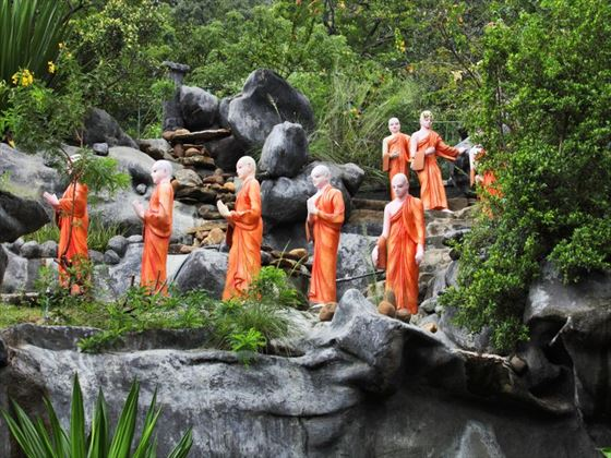 Statues of buddhist monks on a mountain