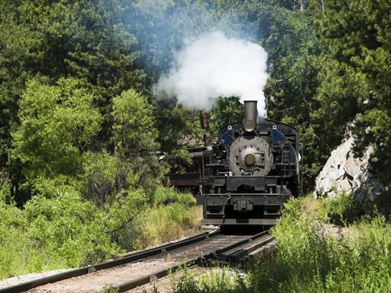 Steam locomotive riding through the Black Hills
