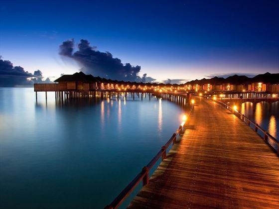 The Sun Siyam Iru Fushi water villas at night