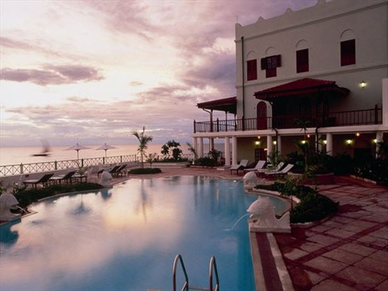 Swimming pool at dusk at Zanzibar Serena