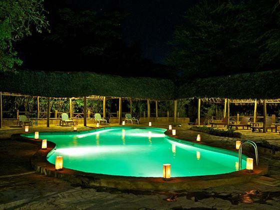 Swimming pool at night at Samburu Intrepids