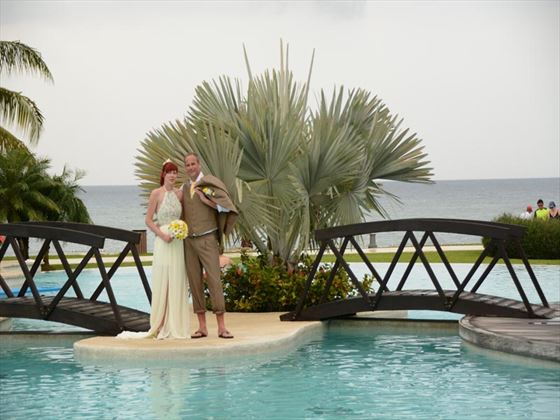 Bride & Groom over the bridge at Secrets Wild Orchid Montego Bay