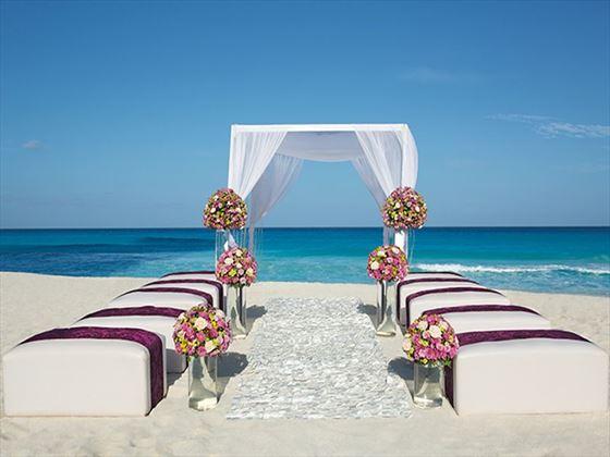 A wedding ceremony set-up on the beach.