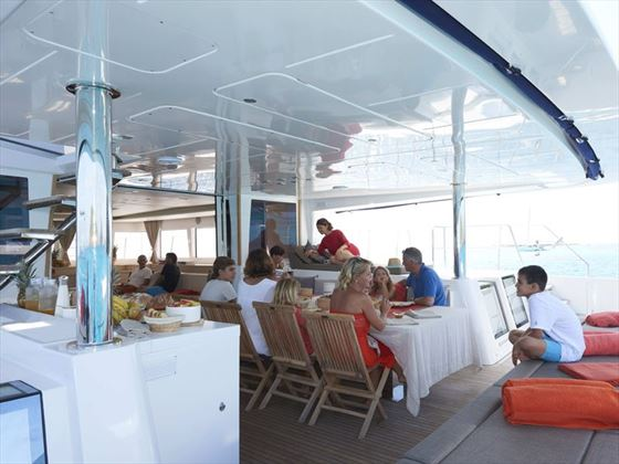Family dining on board Lagoon 620