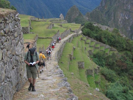 Tour group descending Machu Picchu