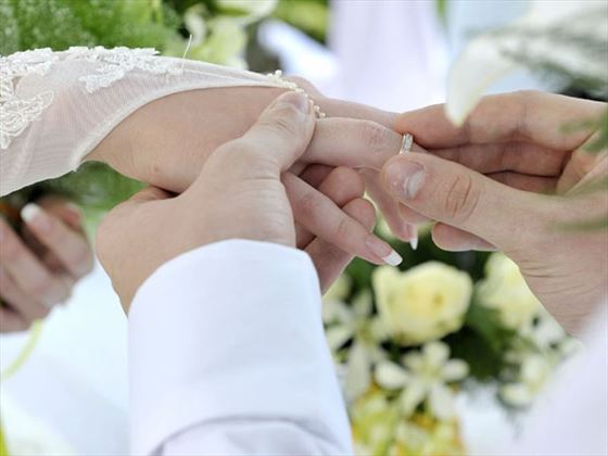 Exchanging wedding rings at the resort
